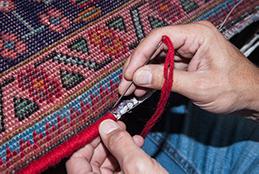Reparatur der Teppichränder zur Stärkung der Widerstandsfähigkeit